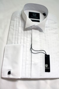A wing collar dress shirt Fly fronted, plain bib. Double cuff, so cuff links required.